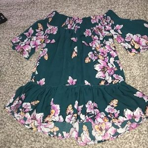 Off the shoulder shirt which flowers
